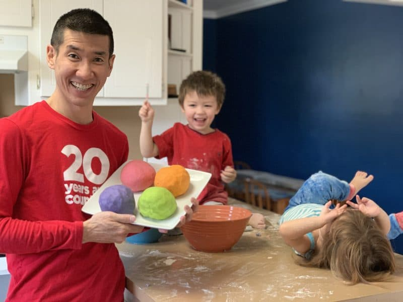 My niece and nephew playing flour while I pose with my first ever batch of homemade playdough.